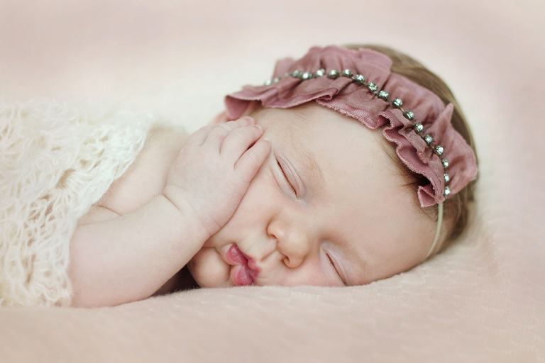 There is nothing cuter than squishy little newborn lips and itty bitty fingers and toes what a princess she is mom and dad are so blessed